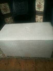Solid faux leather ottoman