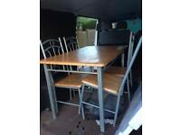 Solid wood table top with Metal frame and chairs