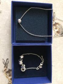 Swarovski silver necklace and matching bracelet.
