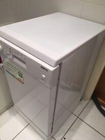 Near new BEKO DE2542FW Slimline Dishwasher perfect for small kitchen.