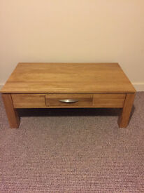 Solid oak coffee table with 2 drawers. (W) 120cm x (H) 45cm x (D) 65cm