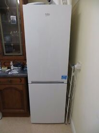Beko fridge freezer with auto defrost as new and one year old with 230L