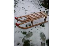 Wooden sledge with metal runners