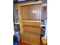 Glass fronted wall unit.