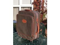 Mulberry carry on size suitcase with two wheels and handle