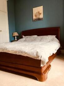 Beautiful cherry veneer wood bed