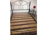 Double Italian style metal bed frame and matching side tables.