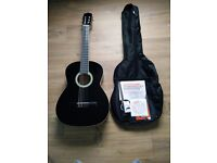 Black Acoustic Guitar with Case, Tuner and Book