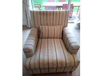 Beautiful chair upholstered in cream, blue and brown stripes.