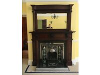 Chrome gas fire with wooden surround and mirror