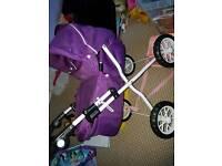 Girls purple silver cross pram