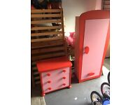 Matching girls pink and red wardrobe and chest of drawers