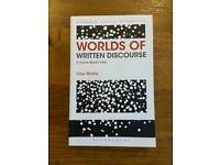 Worlds of Written Discourse: A Genre-Based Review