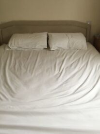Super king size (6ft wide)divan bed and cream velour headboard. Very comfortable
