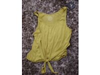 Brand new with tag. Atmosphere Lime green tie button top. Size 12. Can post or collect from torquay.