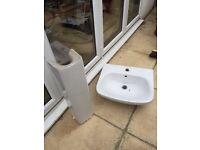 Clean white bathroom pedestal basin