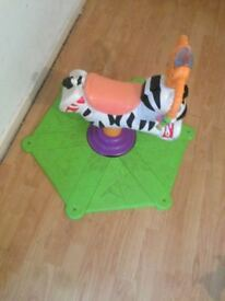 FISHER PRICE BOUNCE AND SPIN ZEBRA, MUSICAL