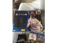 PlayStation 4 with 2 controllers and 9 games FIFA 18