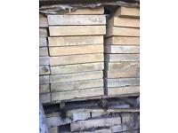A big pallet of yellow slabs