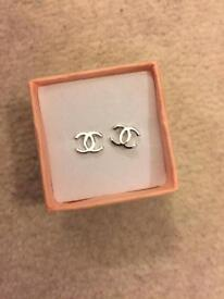 Small cc studs earrings new with box