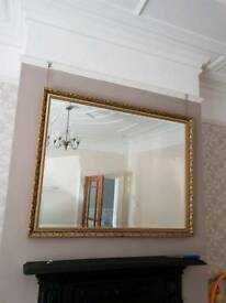 Large gold mirror.