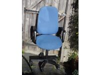 Blue fabric swivel office chair ideal for working on computer.