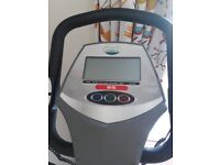 Sturdy Fitness World Cross Trainer measures heart rate & calories burned.