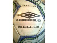 Two leather footballs, one Umbro, the other plain,