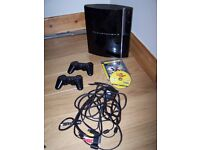 Play Station 3 games console and 2 controllers