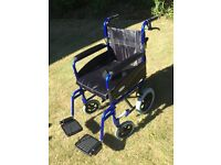 Z Tec Delux Folding Transit Wheelchair with Seat Cushion.