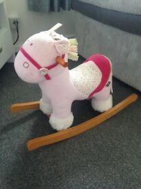 Girls pink rocking horse