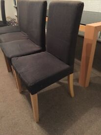 IKEA wooden dining room chairs (set of 8) with grey covers included