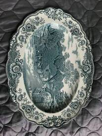 Blue white oval plate.