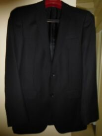 Slim/tall 2 piece suit. 50/50 wool/polyester, black. Perfect condition.