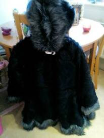 Brand new fully lined faux fur three quarter length coat
