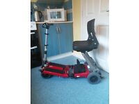 Luggie folding electric Scooter. Very good condition. 18 months old, easy to assemble. With battery.