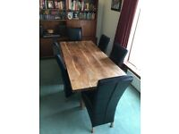 Very solid wood table and chairs
