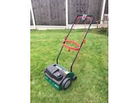 Qualcast electric scarifier and lawn rake