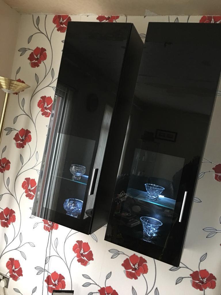 Black units - high gloss glass doors and glass lighting with LED lighting