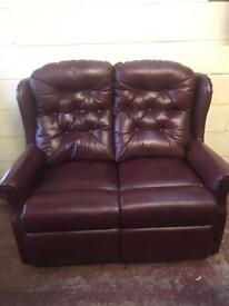 High back burgundy two seater sofa