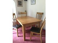 """Solid oak table and 4 chairs measures 4'6"""" x 3' extends 6'6"""" bought 2yrs ago for 900 will except 450"""