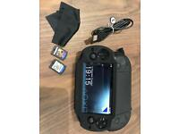 Sony PS Vito + 2 Games, case and memory card