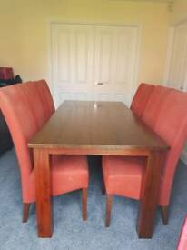 Solid dark wood dining table and 6fabric chairs