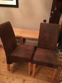 A pair of brown suede effect high back chairs, hardly used