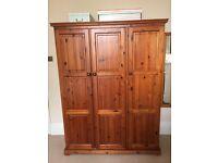 3 door solid, stained pine wardrobe