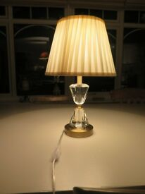 Lovely, almost new, table light with gold and glass base with light cream silk shade -