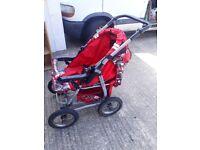 Pushchair - 4 wheel - Red. Unisex