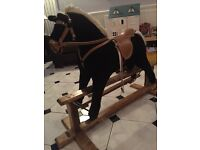 ROCKING HORSE...Mamas & Papas Rocking Horse ...quality item...suite 4-8 yrs approx