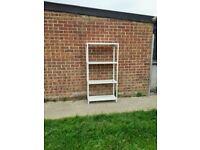 White metal garage or shed, shelves / racking