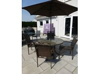 Garden table (120cm diameter), 4 chairs and umbrella - matching set - hardly used.